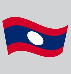 Flag of laos waving on gray background vector