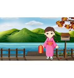 A girl wearing a kimono holding a lantern beside a vector image