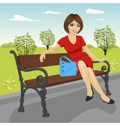 Beautiful young model sitting on a bench vector