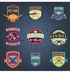 Pop art gun shop logotypes and badges set vector