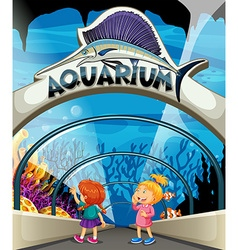 Two girls visiting aquarium vector