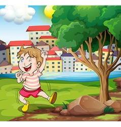 A happy kid near the tree at the riverbank beside vector image vector image