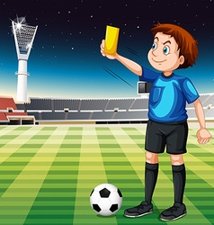Referee showing yellow ticket in football field vector