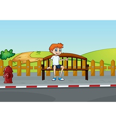 A boy sitting on the bench vector image vector image