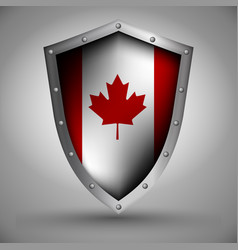 Shield with the canadian flag vector