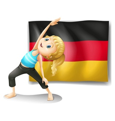 A girl stretching in front of the flag of germany vector