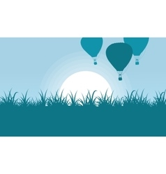 Silhouette of balloon with grass scenery vector