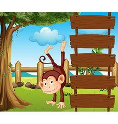 An ape beside the empty wooden signboards vector