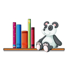A shelf with books and a toy panda vector image