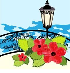 Tropical coastline with lantern fence and flowers vector