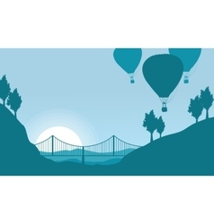 Silhouette of air balloon with bridge scenery vector