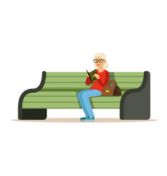 Beautiful senior woman sitting on a wooden bench vector