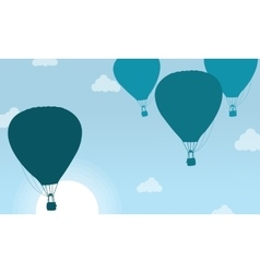 Silhouette of air balloon with cloud scenery vector