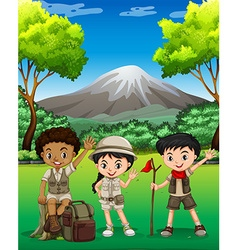 Three kids hiking in the forest vector image