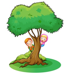 Two girls hiding at the tree vector image vector image