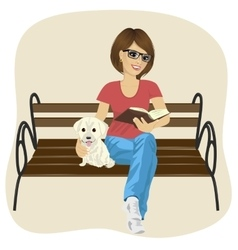 Woman reading book sitting on a bench vector