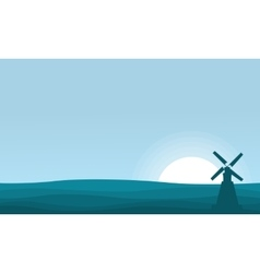 Silhouette of windmill on desert scenery vector image