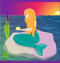 the red-haired mermaid sits on a rock and holds a vector image vector image