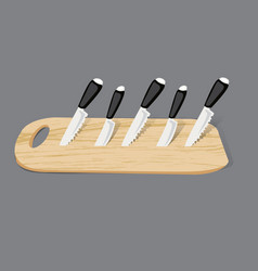 Set of kitchen knives on a board top view vector
