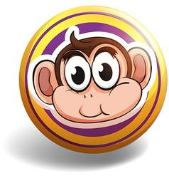 Monkey head on round badge vector image