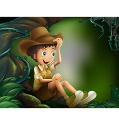 A boy sitting in a tree at the rainforest vector