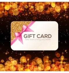 Golden gift card with pink ribbon and bow vector