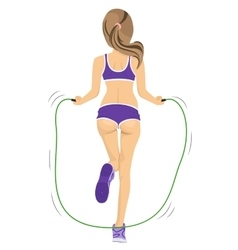 Back view of young fitness woman jumping rope vector