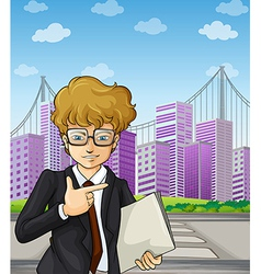 A handsome and smart-looking businessman holding a vector image vector image