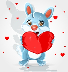 Cute little bunny holds a soft red heart-pillow vector image