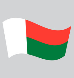 Flag of madagascar waving on gray background vector