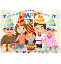 Happy girl blowing birthday candles with her famil vector