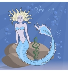 mermaid sitting on the ocean floor vector image