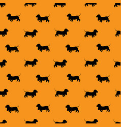 Seamless pattern with black dogs silhouettes - vector