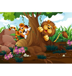 A tiger and a lion playing at the forest vector