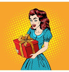 Woman with gift excited woman happy pop art vector