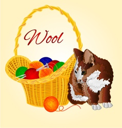 Colors kitten and a basket with balls of wool vector