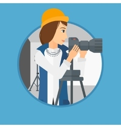 Photographer working with camera on tripod vector