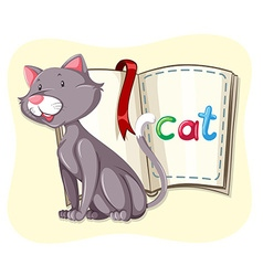 Little cat and a book vector