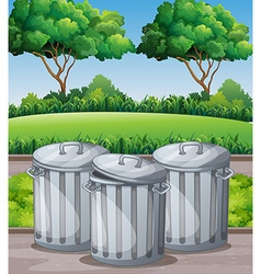 Three trashcans in the park vector