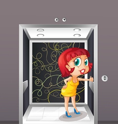 A sexy woman at the elevator vector image