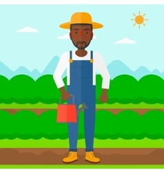 Farmer with watering can vector