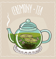 Glass teapot with tea with ginger and lime vector