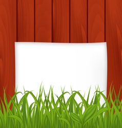Paper sheet and green grass on wooden texture vector