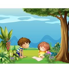 A boy with a girl reading in the garden vector image
