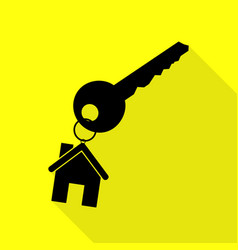 Key with keychain as an house sign black icon vector