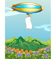 An aircraft with a banner above the mountain vector image vector image