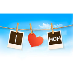 Photos hanging on a clothesline spelling out i vector