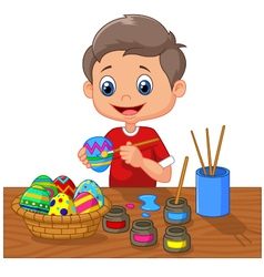 Cartoon boy painting easter egg vector