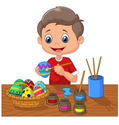 Cartoon boy painting easter egg vector