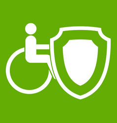 wheelchair and safety shield icon green vector image vector image